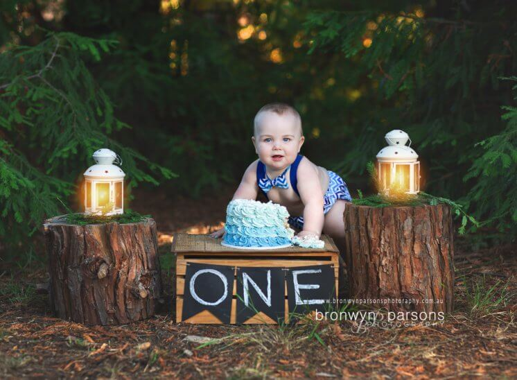 Rustic outdoor cake smash in the forest
